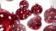 Red Christmas balls  on white background seamless loop video