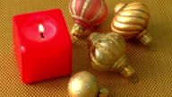 Red christmas candle and christmas ornaments video