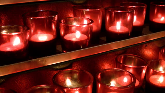 Red church candles on gold shelves. video