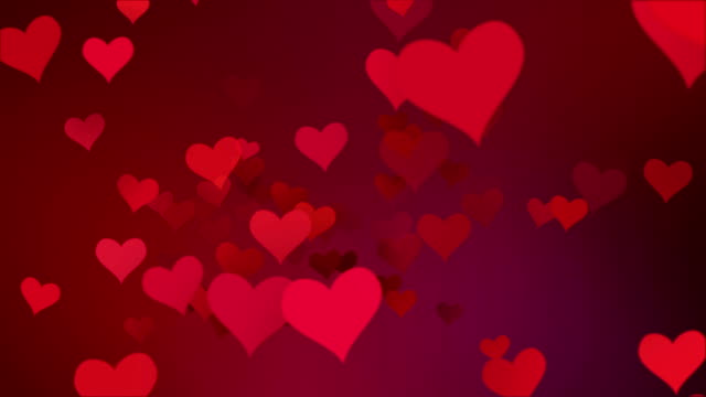red colorful hearts flying with vortex on red purple gradient background video