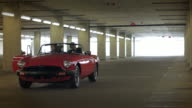 Red Convertible Transforms into a Suitcase video