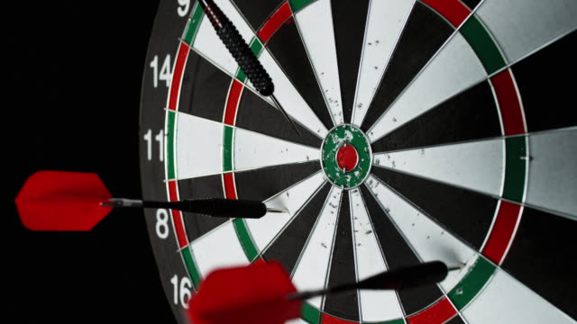 SLO MO of red dart richocheting off a dartboard video