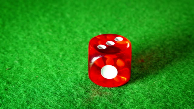 Red dice on the green cloth background. Rotation. Number 3. video