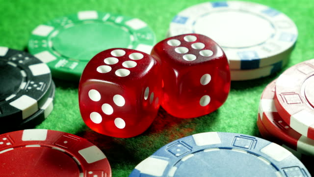 Red dices and casino chips on the green cloth background. Rotation. Double six. Backlight. video