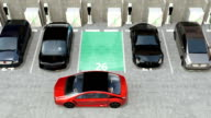 Red electric car driving into parking lot navigated with parking assist system video