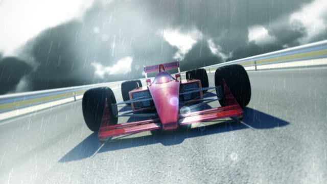 Red F1 Racing Car On Rainy Day video