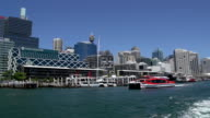 Red ferry leaving Darling Harbour filmed from a ferry video