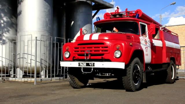 Red firetruck in fire department video