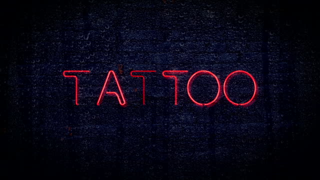 Red flashing tattoo neon sign video
