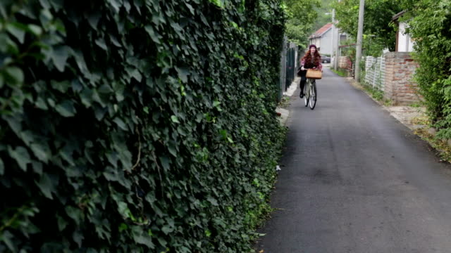 Red hair woman with bicycle video