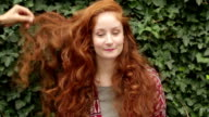 Red hair woman with smart phone video