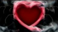 Red heart in smoke loop video