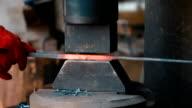 Red hot iron lingot on a press machine video