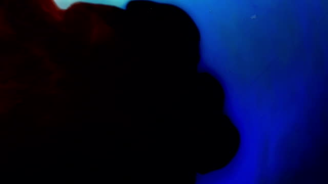 Red Ink Mixing In Blue Ink video