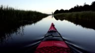 Red kayak in nature video