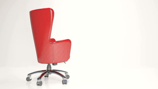Red leather business chair on a light background video
