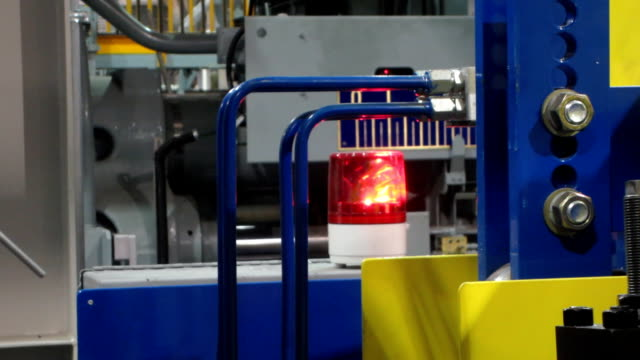 Red light on machine in factory video