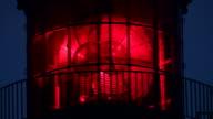 red lighthouse illuminated video