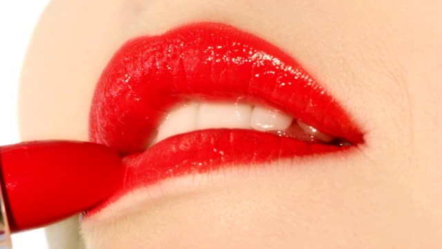 Red lips with lipstick. video