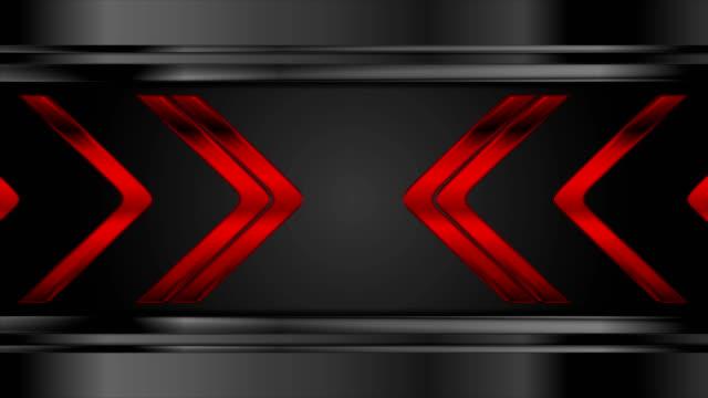 Red metallic arrows on black background video