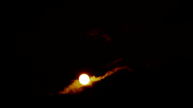 Red moon and clouds video