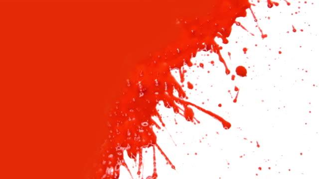 Red paint splattering. Transition. video