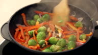 Red Paprika, Brussel Sprouts and Onions Frying on a Pan video