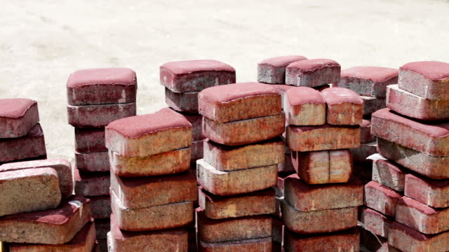 Red paving slabs ready to lay on ground video