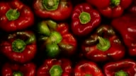 Red peppers stacked together at food market place video
