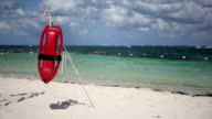 Red plastic buoy for a lifeguard ready to save people video