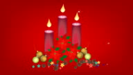 Red Poinsettia Flowers with Christmas Candles and Ornament video
