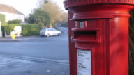 Red Post Box By Busy Road Junction With Traffic video