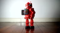 red robot toy video