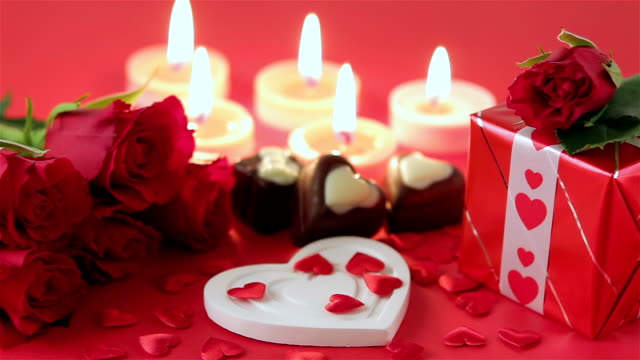 Red roses and chocolate candies for Valentine's Day video