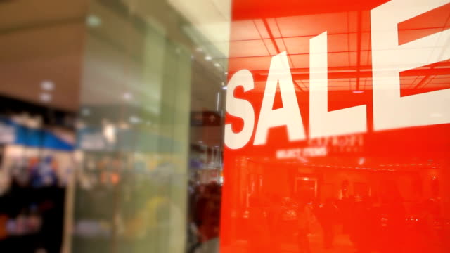 Red Sale Sign in Crowded Shopping Mall video
