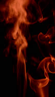 Red smoke on black background vertically flowing video