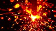 Red sparkler against dark background, macro. Super slow motion shallow focus video, 500 fps video
