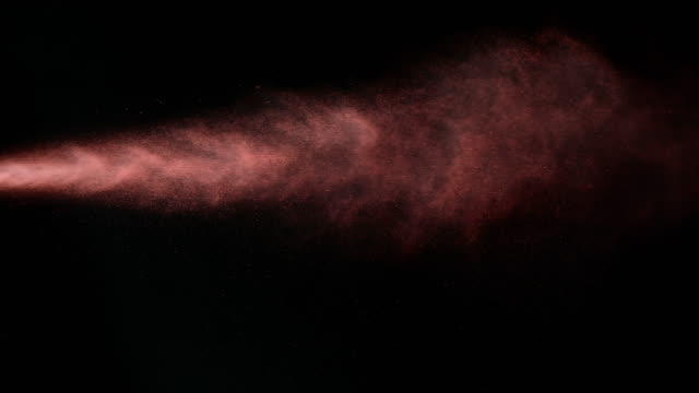 SLO MO red spray paint on black background video
