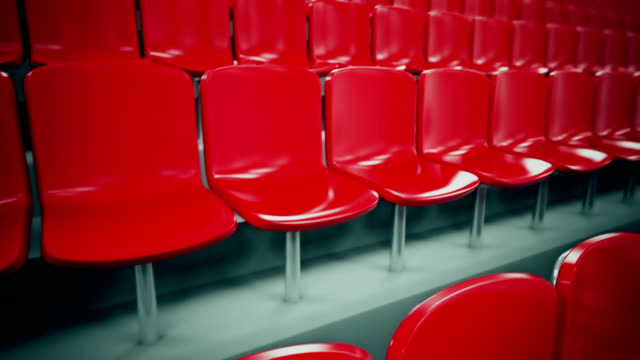 Red stadium seats in a row. Loopable. video