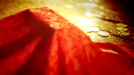 Red velvet uncovered to reveal gold bars video