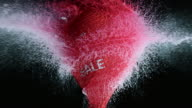 SLO MO red water filled balloon with sale sign exploding video