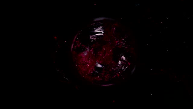 Red wine falls into the glass top video