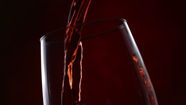 Red wine pour series, slow motion video
