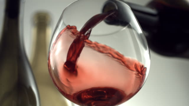 Red wine pouring, slow motion video