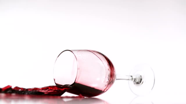 Red wine splashing out of glass, Slow Motion video
