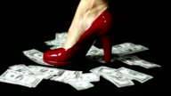 Red woman shoe on money video