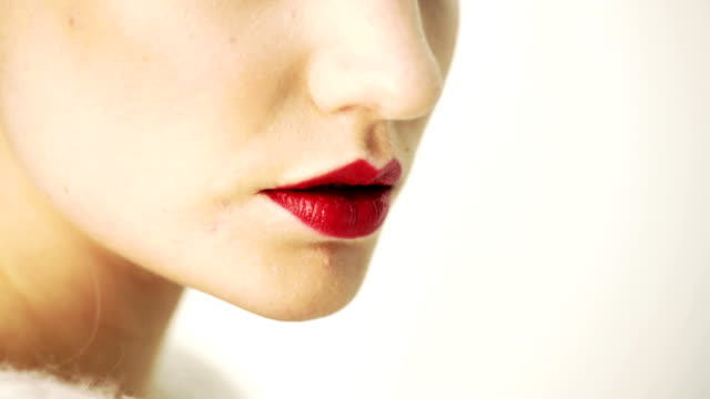 Red Women Lips And Eyes. Extreme Close Up. Edited video