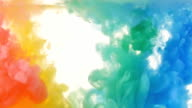 Red, yellow, green and blue ink in water. Bright, vivid, colourful background. Slow motion video