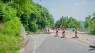 Red yugo passing road works video