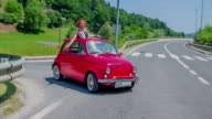 Red yugo pulls back up to the main road video